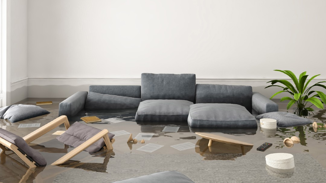 flooded living room with floating sofa, The Best Flood Insurance Company Near You