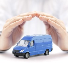 two hands build a shield above a transporter toy, general liability insurance, commercial insurance