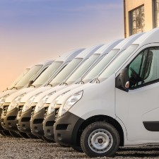 white transporters lined up, commercial car insurance, commercial insurance