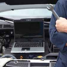 car engine analyzed on laptop, garage liability insurance, commercial insurance
