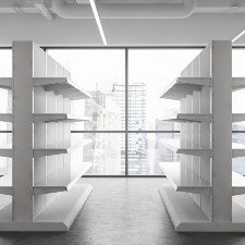 a room with white production shelves that reach the ceiling, glass windows with city view, product liability insurance, commercial insurance