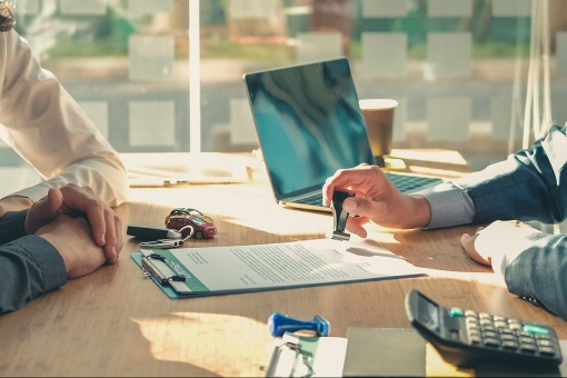a businessman and an insurance advisor going through a management liability insurance, insurance agency Miami FL