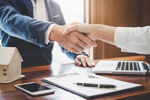 two businessmen shaking hands, professional insurance agency in Palm City FL