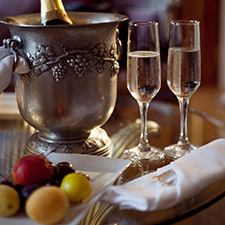 filled champagne glasses and silverware