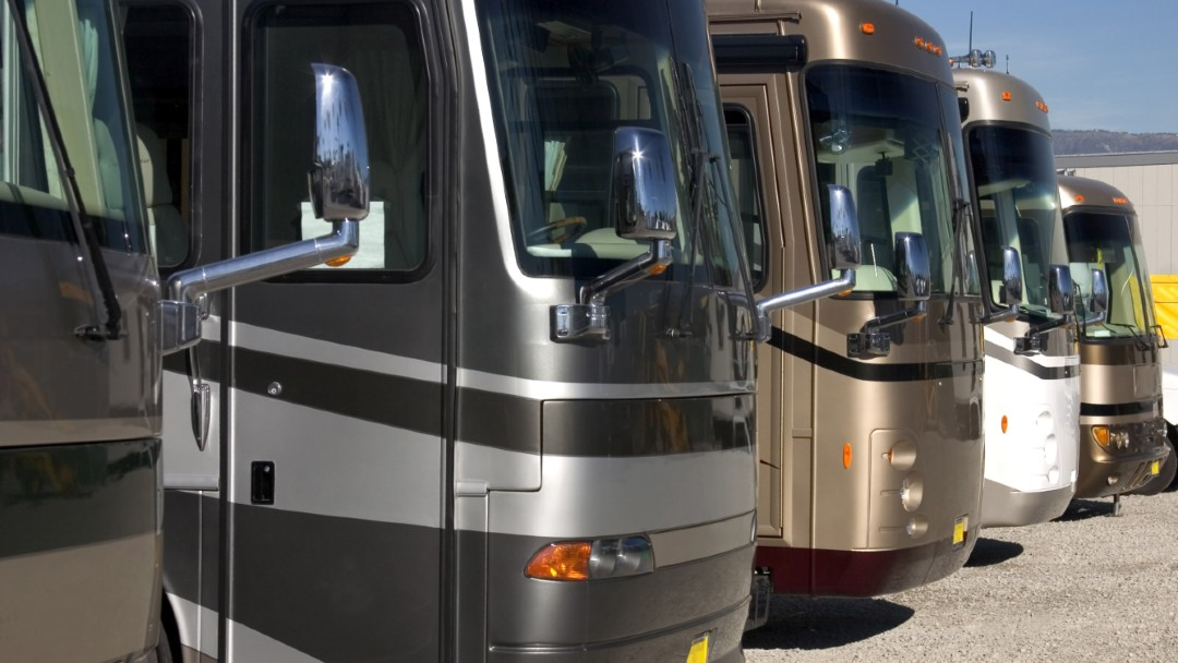 few luxury RVs parked next to each other, best recreational vehicle RV insurance coverage