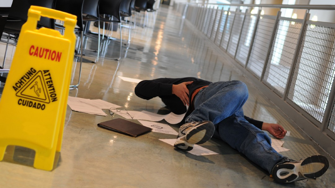 man felt on wet floor, the best workers compensation insurance for your business in Florida
