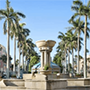 a stone fountain in a courtyard flanked by palm trees in Boca Raton, Florida, JAISIN Insurance Solutions