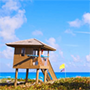 a lifeguard hut on the beach near the ocean in Delray Beach, Florida, JAISIN Insurance Solutions