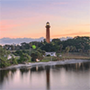 a silhouette of a lighthouse at sundown on the coast of Jupiter, Florida, JAISIN Insurance Solutions