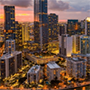 the city of Miami at sundown with lights glittering in the buildings, Florida, JAISIN Insurance Solutions