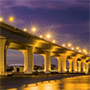 a bridge over a river illuminated by lights in Palm City, Florida, JAISIN Insurance Solutions