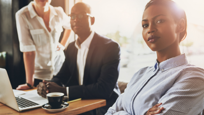 a group of business people sitting on a table, Must-Read Guide to Business Insurance, JAISIN Insurance Solutions