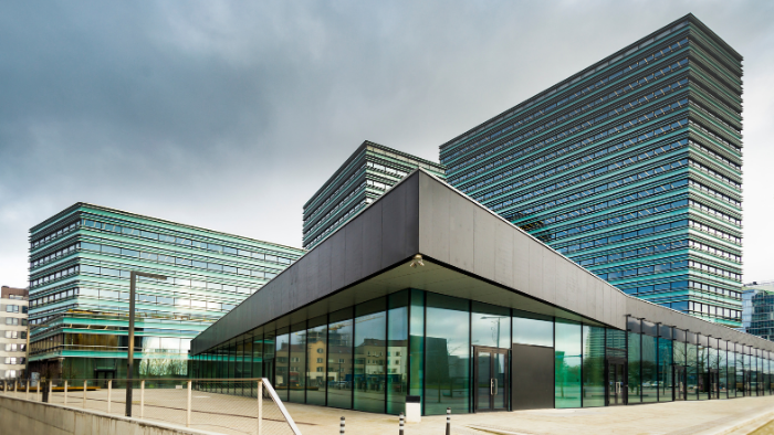 commercial glass building, Must-Read Guide for Commercial Property and Liability Insurance, JAISIN Insurance Solutions