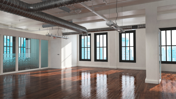 An industrial office with wood floors, exposed pipes, and white walls, JAISIN Insurance Solutions