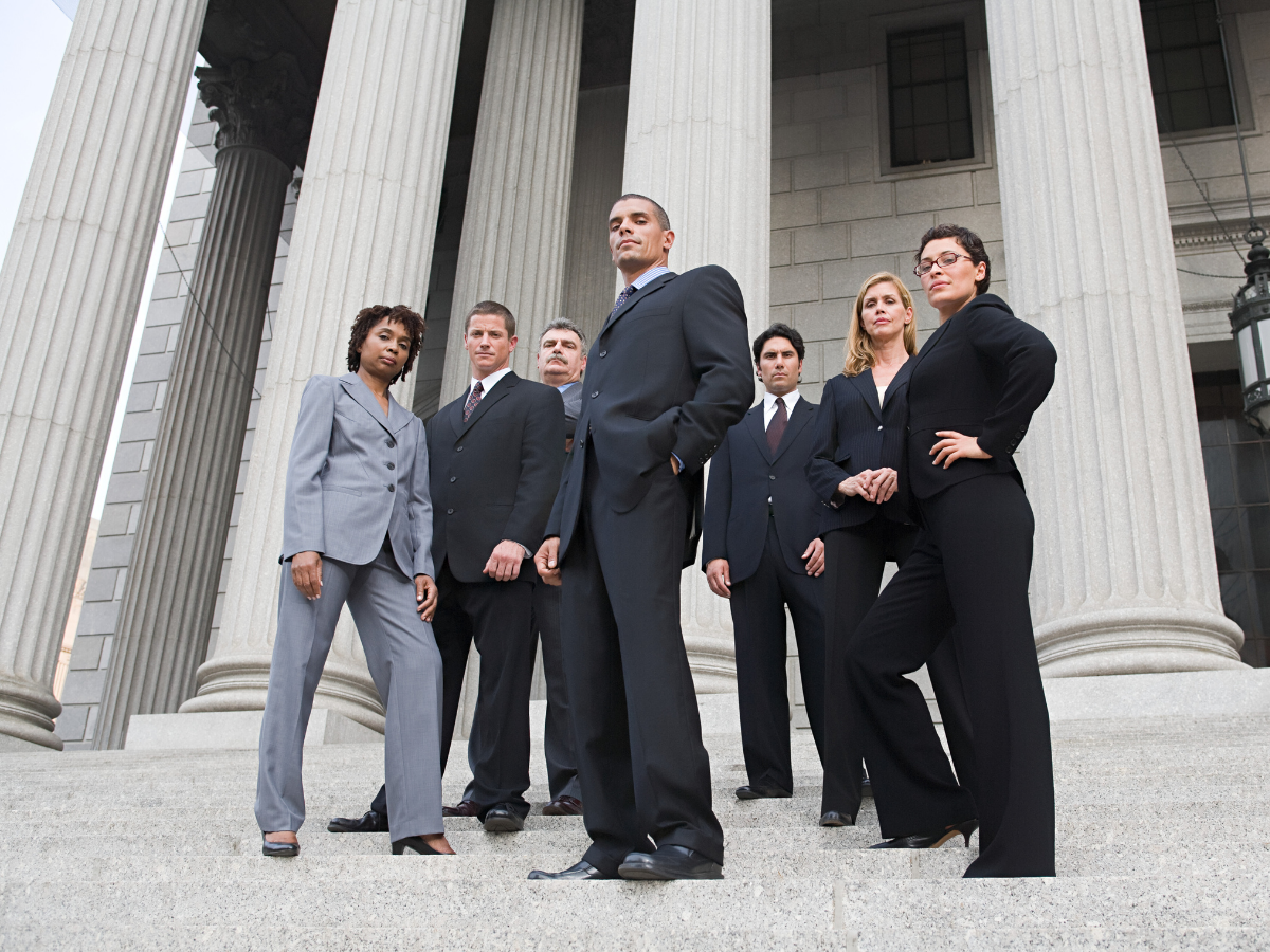 six attorneys lined up on the steps of a courthouse, JAISIN Insurance Solutions